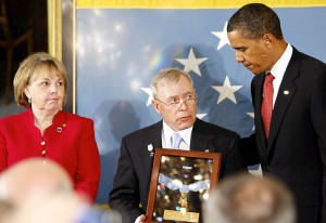 President Barack Obama posthumously awards Army Sgt. 1st. Class Jared C. Monti from Raynham, Mass., the Medal of Honor for his service in Afghanistan, to his parents Paul and Janet Monti, Thursday, Sept. 17, 2009, in the East Room of the White House in Washington. (AP Photo/Charles Dharapak)   Original Filename: Obama_WHCD124.jpg