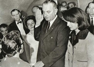 LBJ swears in aboard Air Force One in Dallas, TX following the assasination of John F. Kennedy on 22 November, 1963. Visible on Johnson's left lapel is the Silver Star, which he wore prominently throughout his career as a politician.