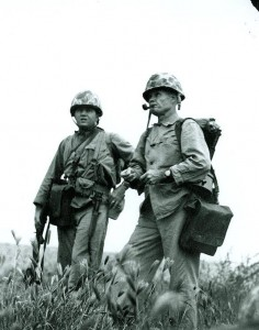 Colonel Lewis B. Puller, USMC. Studies the terrain before advancing to another enemy objective, during operations beyond Inchon, Korea, circa September 1950. He was in command of the Marine Regimental Combat Team One of the First Marine Division. Courtesy of the U.S. Naval Institute, Annapolis, Maryland, NHHC Photograph Collection, NH 93034.